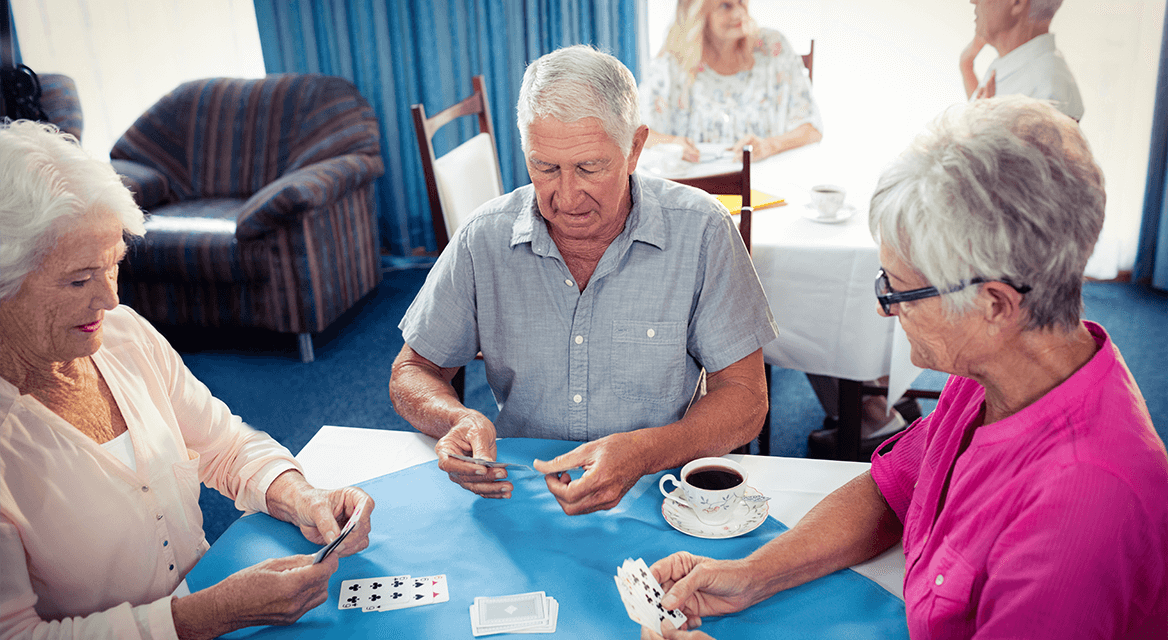 Seniors Playing Cards at Skilled Nursing Facility